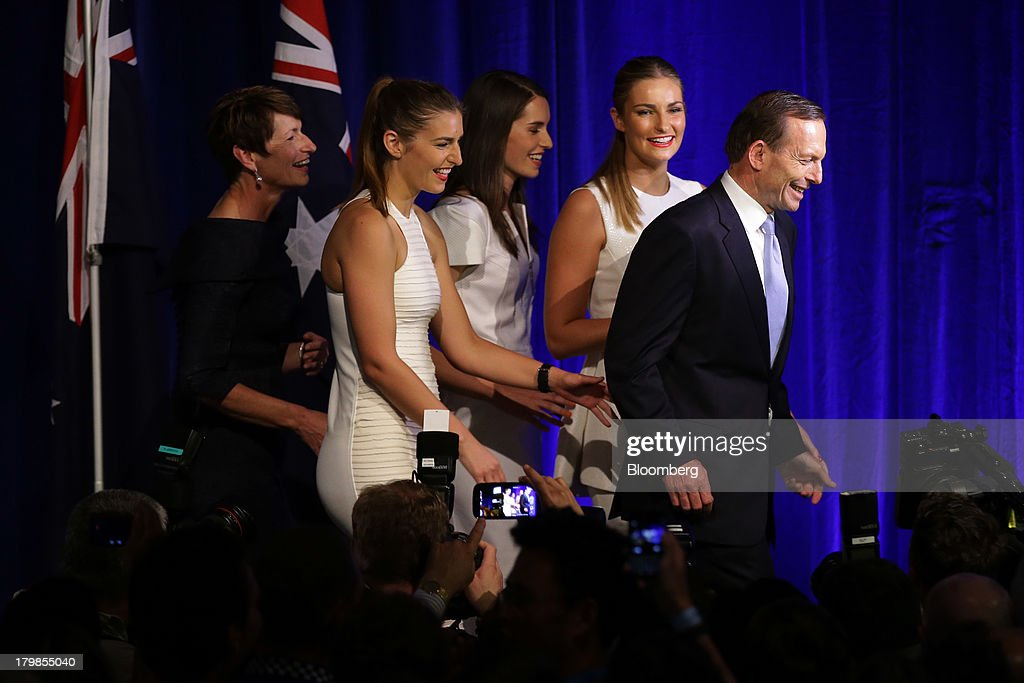 <a gi-track='captionPersonalityLinkClicked' href=/galleries/search?phrase=Tony+Abbott&family=editorial&specificpeople=220956 ng-click='$event.stopPropagation()'>Tony Abbott</a>, Australia's prime minister-elect, right, walks along the stage with his wife Margie Abbott, from left, and their daughters Frances Abbott, Louise Abbott, and Bridget Abbott after delivering his victory speech at the Liberal-National coalition's election function in Sydney, Australia, on Saturday, Sept. 7, 2013. <a gi-track='captionPersonalityLinkClicked' href=/galleries/search?phrase=Tony+Abbott&family=editorial&specificpeople=220956 ng-click='$event.stopPropagation()'>Tony Abbott</a>'s Liberal-National coalition won Australia's election, consigning Kevin Rudd's Labor party to the shortest stint in power in almost 40 years and ushering in a government pledging to abolish carbon and mining taxes. Photographer: Brendon Thorne/Bloomberg via Getty Images