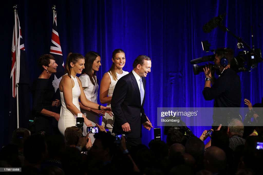 <a gi-track='captionPersonalityLinkClicked' href=/galleries/search?phrase=Tony+Abbott&family=editorial&specificpeople=220956 ng-click='$event.stopPropagation()'>Tony Abbott</a>, Australia's prime minister-elect, second right, walks along the stage with his wife Margie Abbott, from left, and their daughters Frances Abbott, Louise Abbott, and Bridget Abbott after delivering his victory speech at the Liberal-National coalition's election function in Sydney, Australia, on Saturday, Sept. 7, 2013. <a gi-track='captionPersonalityLinkClicked' href=/galleries/search?phrase=Tony+Abbott&family=editorial&specificpeople=220956 ng-click='$event.stopPropagation()'>Tony Abbott</a>'s Liberal-National coalition won Australia's election, consigning Kevin Rudd's Labor party to the shortest stint in power in almost 40 years and ushering in a government pledging to abolish carbon and mining taxes. Photographer: Brendon Thorne/Bloomberg via Getty Images
