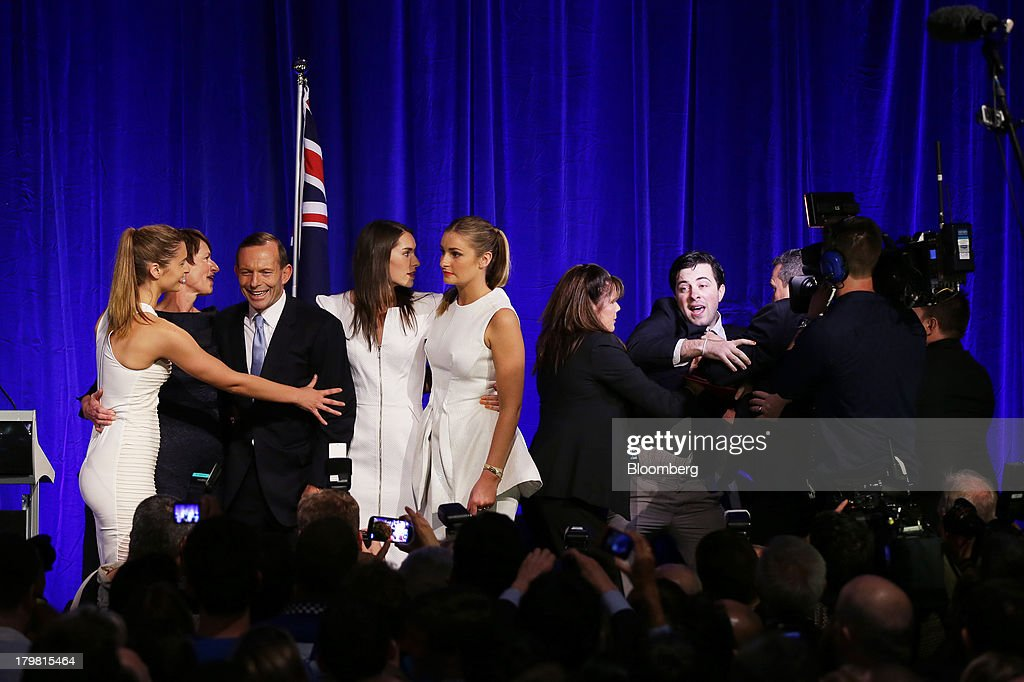 <a gi-track='captionPersonalityLinkClicked' href=/galleries/search?phrase=Tony+Abbott&family=editorial&specificpeople=220956 ng-click='$event.stopPropagation()'>Tony Abbott</a>, Australia's prime minister-elect, third left, stands with his wife Margie Abbott, second left, and their daughters Frances Abbott, left, Louise Abbott, fourth left, and Bridget Abbott, fifth left, as security officers remove an intruder on the stage at the Liberal-National coalition's election function in Sydney, Australia, on Saturday, Sept. 7, 2013. <a gi-track='captionPersonalityLinkClicked' href=/galleries/search?phrase=Tony+Abbott&family=editorial&specificpeople=220956 ng-click='$event.stopPropagation()'>Tony Abbott</a>'s Liberal-National coalition won Australia's election, consigning Kevin Rudd's Labor party to the shortest stint in power in almost 40 years and ushering in a government pledging to abolish carbon and mining taxes. Photographer: Brendon Thorne/Bloomberg via Getty Images