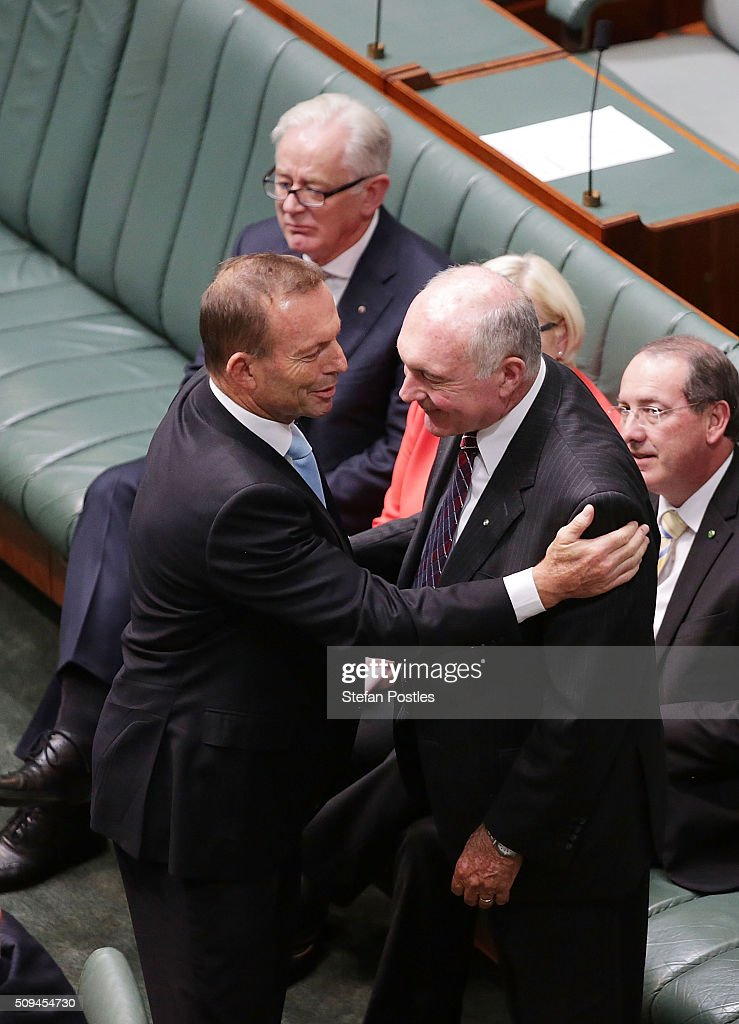 Tony Abbott congratulates Deputy Prime Minister Warren Truss after he announced his retirement in the House of Representatives on February 11, 2016 in Canberra, Australia. Nationals Leader and Deputy Prime Minister Warren Truss and Trade Minister Andrew Robb will retire at the next election.