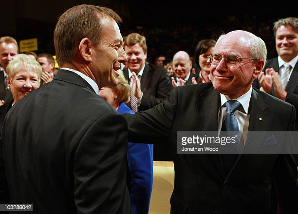 Tony Abbott is greeted by former Australian Prime Minister John Howard during the 2010 Coalition Campaign Launch at the Queensland Performing Arts...