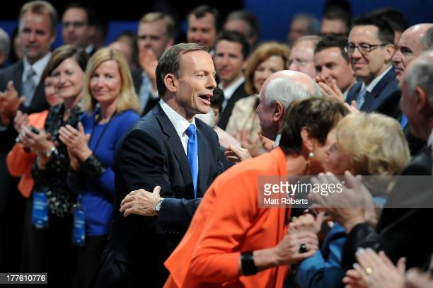 Tony Abbott is welcomed by former Prime Mnister John Howard during the 2013 Coalition Campaign Launch at the Queensland Performing Arts Centre on...