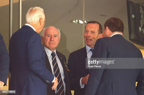 Tony Abbott Prime Minister of Australia and Former Prime Minister John Howard look on during day one of the Fifth Ashes Test match between Australia...