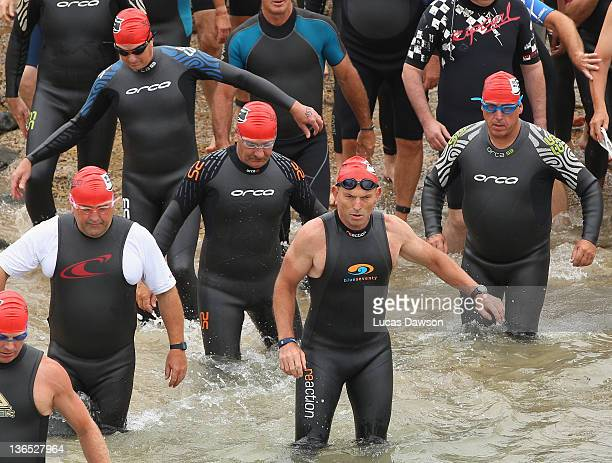Tony Abbott the Federal Leader of the Opposition runs in to the water during the 2012 Pier to Pub on January 7 2012 in Lorne Australia