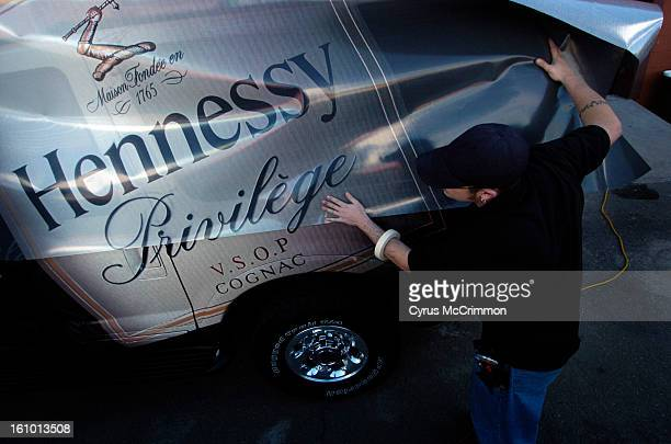 DENVER CO MONDAY FEBUARY 14 2005 Tony Abeyta production installer for Qube Visual at 1247 Santa Fe Drive does a car wrap for Hennessy Privilege...