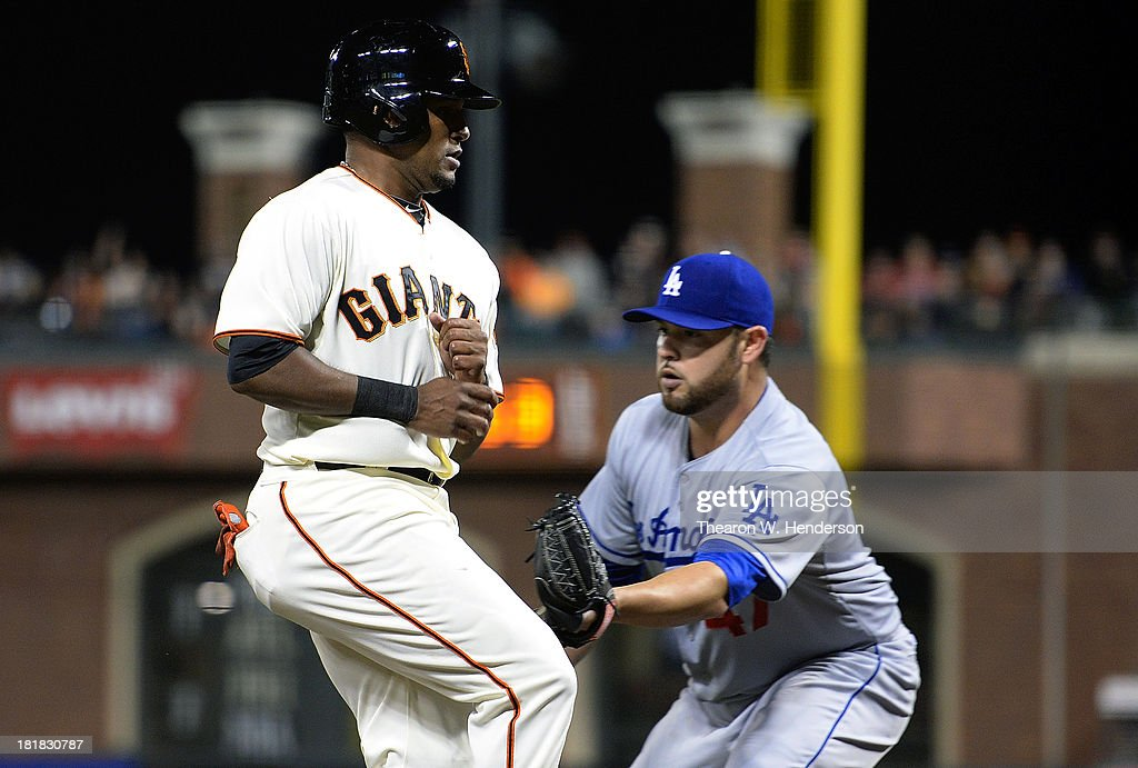 <a gi-track='captionPersonalityLinkClicked' href=/galleries/search?phrase=Tony+Abreu&family=editorial&specificpeople=840737 ng-click='$event.stopPropagation()'>Tony Abreu</a> #10 of the San Francisco Giants gets caught in a rundown between third base and home, and gets tagged out by pitcher <a gi-track='captionPersonalityLinkClicked' href=/galleries/search?phrase=Ricky+Nolasco&family=editorial&specificpeople=600111 ng-click='$event.stopPropagation()'>Ricky Nolasco</a> #47 of the Los Angeles Dodgers during the second inning at AT&T Park on September 25, 2013 in San Francisco, California.