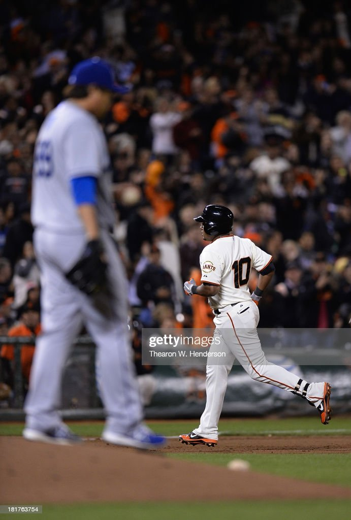 <a gi-track='captionPersonalityLinkClicked' href=/galleries/search?phrase=Tony+Abreu&family=editorial&specificpeople=840737 ng-click='$event.stopPropagation()'>Tony Abreu</a> #10 of the San Francisco Giants trots around the bases after he hit a solo home run off of Hyun-Jin Ryu #99 of the Los Angeles Dodgers during the fifth inning at AT&T Park on September 24, 2013 in San Francisco, California.