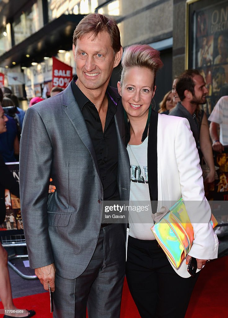 Tony Adams and Poppy Teacher attend the 'One Direction This Is Us' world premiere at the Empire Leicester Square on August 20, 2013 in London, England.
