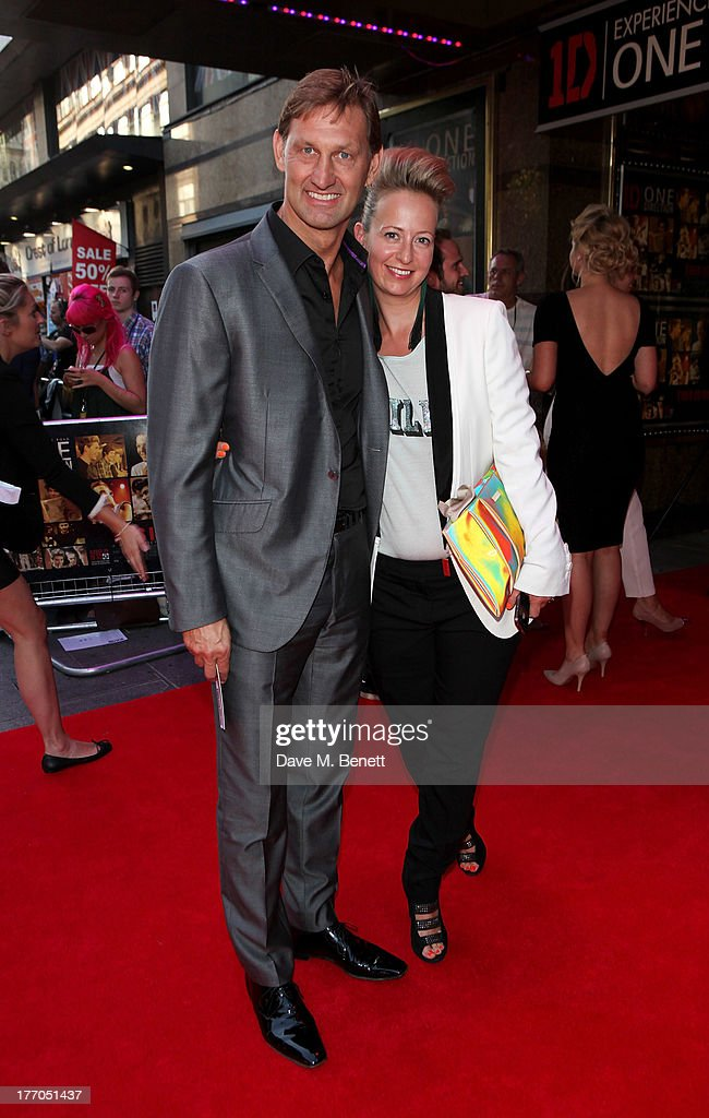 Tony Adams (L) and Poppy Teacher attend the World Premiere of 'One Direction: This Is Us 3D' at Empire Leicester Square on August 20, 2013 in London, England.