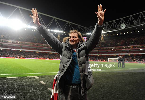 Tony Adams ex Arsenal player waves to the crowd at half time of the match between Arsenal and Manchester United in the Barclays Premier League at...