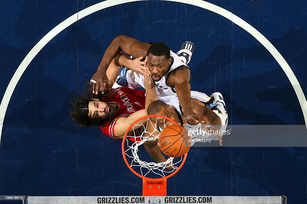 <a gi-track='captionPersonalityLinkClicked' href=/galleries/search?phrase=Tony+Allen+-+Basketball+Player&family=editorial&specificpeople=201665 ng-click='$event.stopPropagation()'>Tony Allen</a> #9 and <a gi-track='captionPersonalityLinkClicked' href=/galleries/search?phrase=Marreese+Speights&family=editorial&specificpeople=4187263 ng-click='$event.stopPropagation()'>Marreese Speights</a> #5 of the Memphis Grizzlies fight for a rebound against <a gi-track='captionPersonalityLinkClicked' href=/galleries/search?phrase=Luis+Scola&family=editorial&specificpeople=2464749 ng-click='$event.stopPropagation()'>Luis Scola</a> #4 of the Houston Rockets on February 14, 2012 at FedExForum in Memphis, Tennessee.