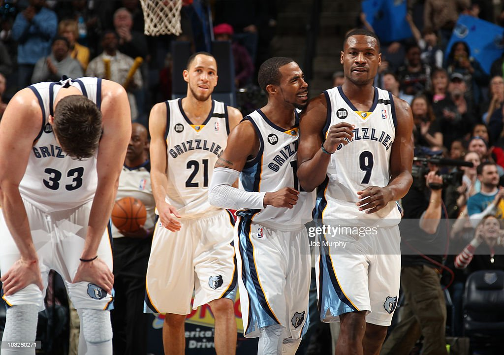 Tony Allen #9 and Mike Conley #11 of the Memphis Grizzlies celebrate during a game against the Portland Trail Blazers on March 6, 2013 at FedExForum in Memphis, Tennessee.