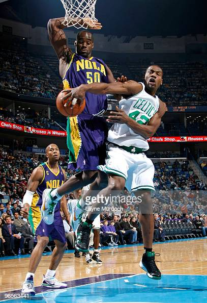 Tony Allen of the Boston Celtics attempts to pass the ball around Emeka Okafor and David West of the New Orleans Hornets on February 10 2010 at the...