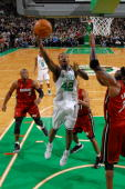Tony Allen of the Boston Celtics lays the ball up in the lane against Jermaine O' Neal of the Miami Heat on February 3 2010 at the TD Garden in...