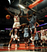 Tony Allen of the Memphis Girzzlies passes the ball around Loul Deng of the Chicago Bulls at the United Center on March 25 2011 in Chicago Illinois...