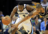 Tony Allen of the Memphis Grizzlies and Tim Duncan of the San Antonio Spurs go after a loose ball in the first quarter during Game Three of the...