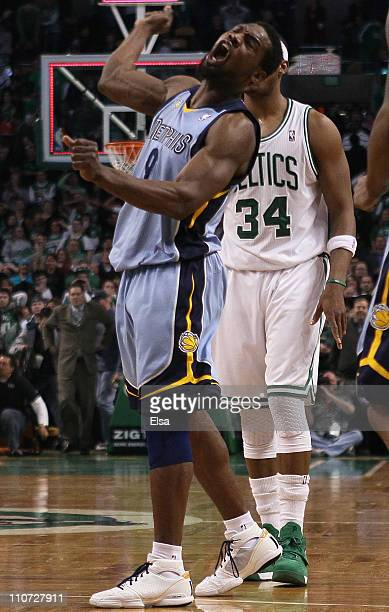 Tony Allen of the Memphis Grizzlies celebrates the win as Paul Pierce of the Boston Celtics stands by on March 23 2011 at the TD Garden in Boston...