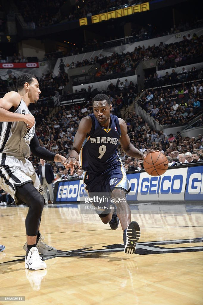 Tony Allen #9 of the Memphis Grizzlies drives to the basket against Danny Green #4 of the San Antonio Spurs at the AT&T Center on October 30, 2013 in San Antonio, Texas.