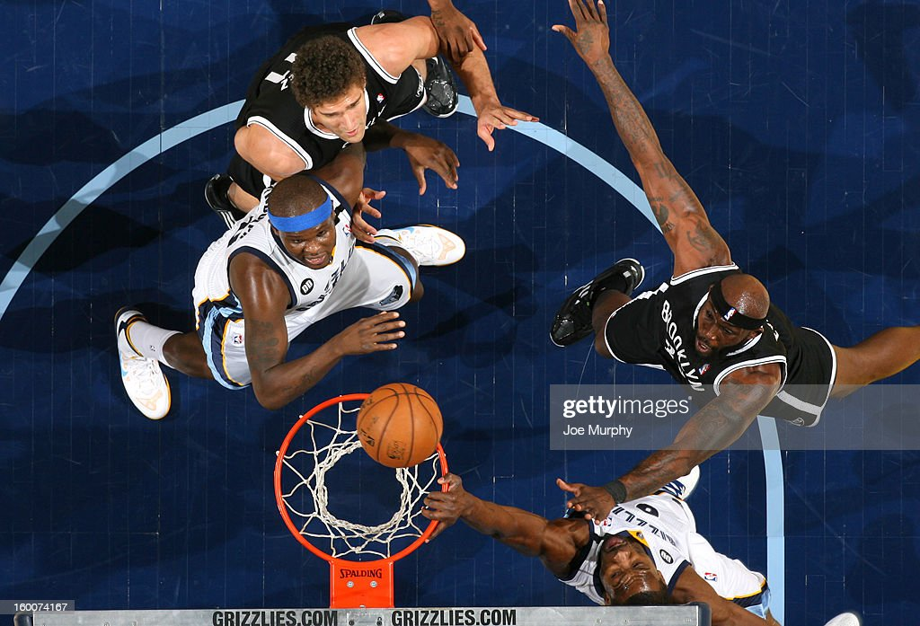 Tony Allen #9 of the Memphis Grizzlies dunks against Reggie Evans #30 of the Brooklyn Nets on January 25, 2013 at FedExForum in Memphis, Tennessee.