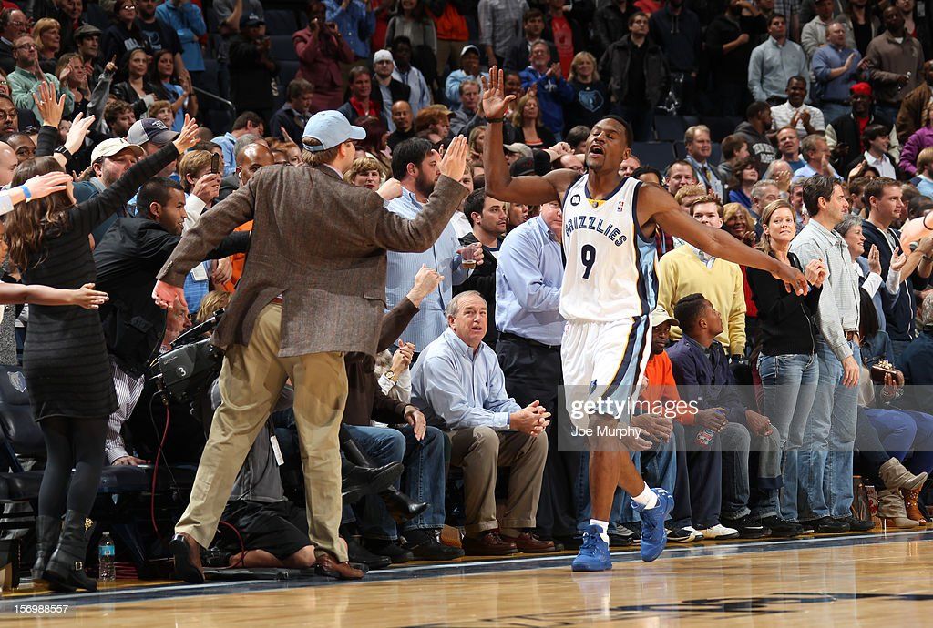 Tony Allen #9 of the Memphis Grizzlies gives a fan a high five during a game against the Cleveland Cavaliers on November 26, 2012 at FedExForum in Memphis, Tennessee.