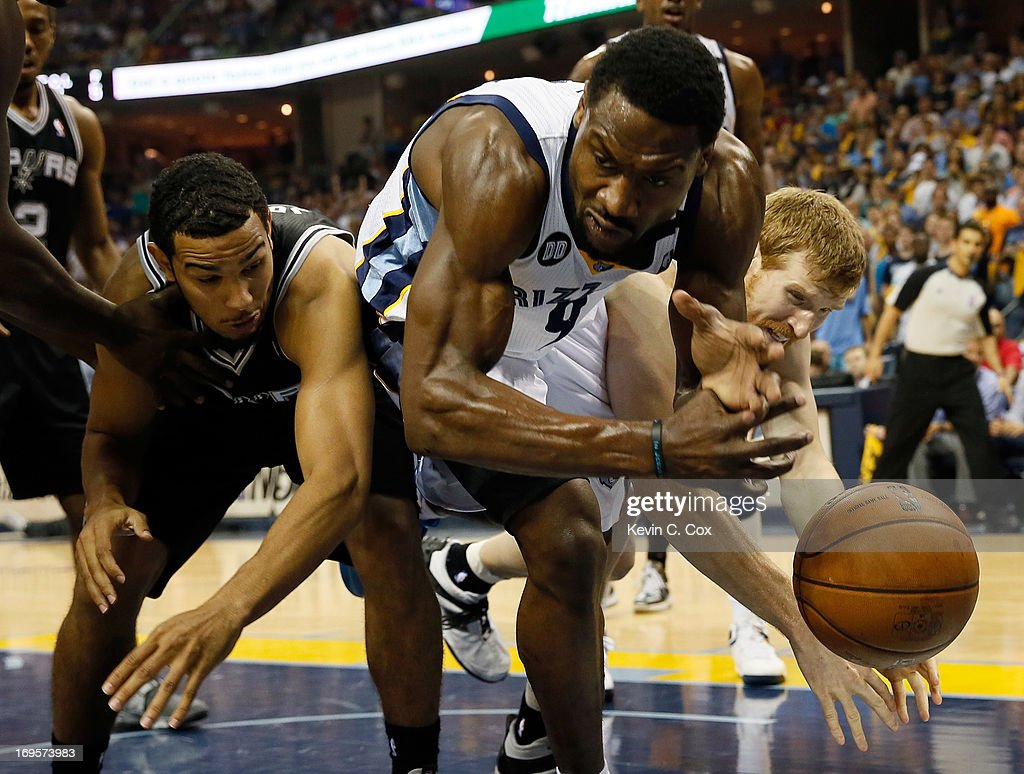 <a gi-track='captionPersonalityLinkClicked' href=/galleries/search?phrase=Tony+Allen+-+Basketball+Player&family=editorial&specificpeople=201665 ng-click='$event.stopPropagation()'>Tony Allen</a> #9 of the Memphis Grizzlies goes for the ball between <a gi-track='captionPersonalityLinkClicked' href=/galleries/search?phrase=Cory+Joseph&family=editorial&specificpeople=5953537 ng-click='$event.stopPropagation()'>Cory Joseph</a> #5 and <a gi-track='captionPersonalityLinkClicked' href=/galleries/search?phrase=Matt+Bonner&family=editorial&specificpeople=203054 ng-click='$event.stopPropagation()'>Matt Bonner</a> #15 of the San Antonio Spurs in the second half during Game Four of the Western Conference Finals of the 2013 NBA Playoffs at the FedExForum on May 27, 2013 in Memphis, Tennessee.