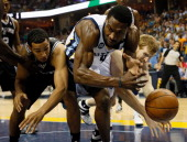 Tony Allen of the Memphis Grizzlies goes for the ball between Cory Joseph and Matt Bonner of the San Antonio Spurs in the second half during Game...