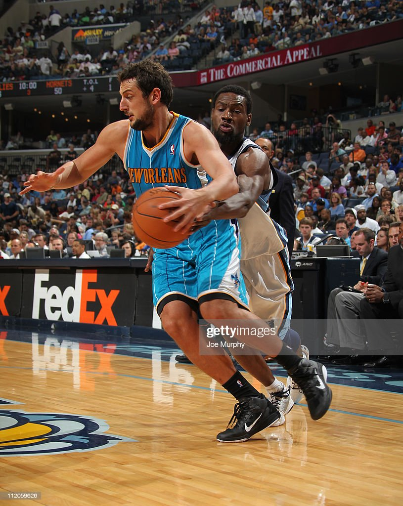 <a gi-track='captionPersonalityLinkClicked' href=/galleries/search?phrase=Tony+Allen+-+Basketball+Player&family=editorial&specificpeople=201665 ng-click='$event.stopPropagation()'>Tony Allen</a> #9 of the Memphis Grizzlies goes for the steal against <a gi-track='captionPersonalityLinkClicked' href=/galleries/search?phrase=Marco+Belinelli&family=editorial&specificpeople=847592 ng-click='$event.stopPropagation()'>Marco Belinelli</a> #8 of the New Orleans Hornets during the game on April 10, 2011 at FedExForum in Memphis, Tennessee.