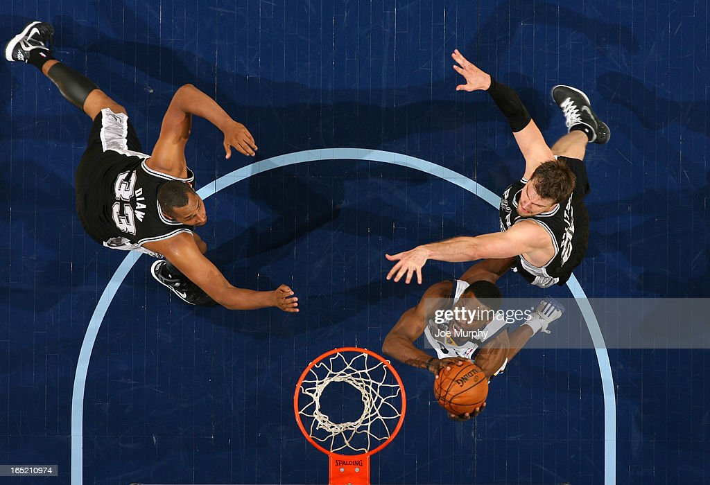 <a gi-track='captionPersonalityLinkClicked' href=/galleries/search?phrase=Tony+Allen+-+Basketball+Player&family=editorial&specificpeople=201665 ng-click='$event.stopPropagation()'>Tony Allen</a> #9 of the Memphis Grizzlies goes to the basket against <a gi-track='captionPersonalityLinkClicked' href=/galleries/search?phrase=Tiago+Splitter&family=editorial&specificpeople=208218 ng-click='$event.stopPropagation()'>Tiago Splitter</a> #22 of the San Antonio Spurs on April 1, 2013 at FedExForum in Memphis, Tennessee.