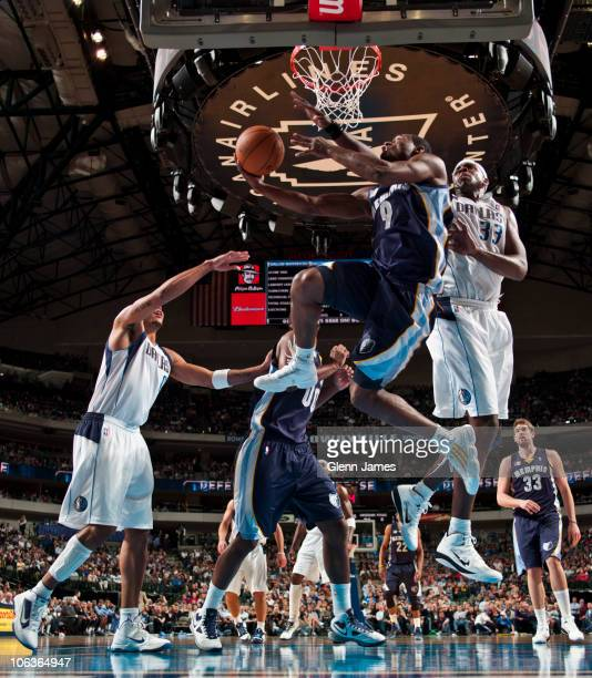 Tony Allen of the Memphis Grizzlies goes up and under against Brendan Haywood of the Dallas Mavericks during a game on October 29 2010 at the...
