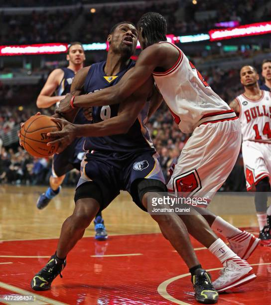 Tony Allen of the Memphis Grizzlies is fouled by Tony Snell of the Chicago Bulls at the United Center on March 7 2014 in Chicago Illinois NOTE TO...
