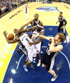 Tony Allen of the Memphis Grizzlies is hit in the face by teammate Zach Randolph against Tony Parker of the San Antonio Spurs during Game Three of...