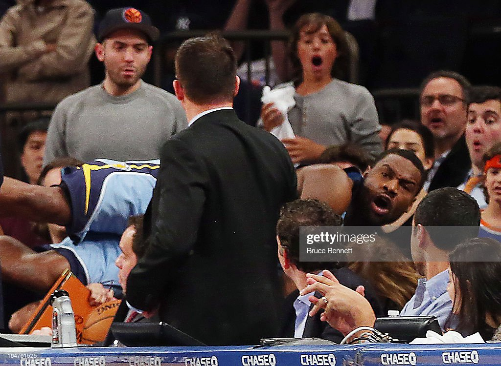 Tony Allen #9 of the Memphis Grizzlies lands in the crowd following a ball in the game against the New York Knicks at Madison Square Garden on March 27, 2013 in New York City. The Knicks defeated the Grizzlies 108-101.
