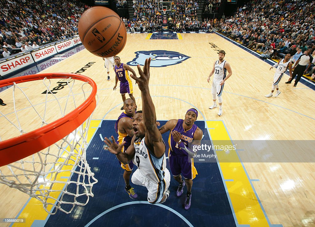 Tony Allen #9 of the Memphis Grizzlies shoots a layup against Kobe Bryant #24 and Dwight Howard #12 of the Los Angeles Lakers on November 23, 2012 at FedExForum in Memphis, Tennessee.