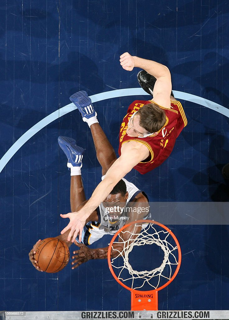 <a gi-track='captionPersonalityLinkClicked' href=/galleries/search?phrase=Tony+Allen+-+Basketball+Player&family=editorial&specificpeople=201665 ng-click='$event.stopPropagation()'>Tony Allen</a> #9 of the Memphis Grizzlies shoots a layup against <a gi-track='captionPersonalityLinkClicked' href=/galleries/search?phrase=Tyler+Zeller&family=editorial&specificpeople=5122156 ng-click='$event.stopPropagation()'>Tyler Zeller</a> #40 of the Cleveland Cavaliers on November 26, 2012 at FedExForum in Memphis, Tennessee.