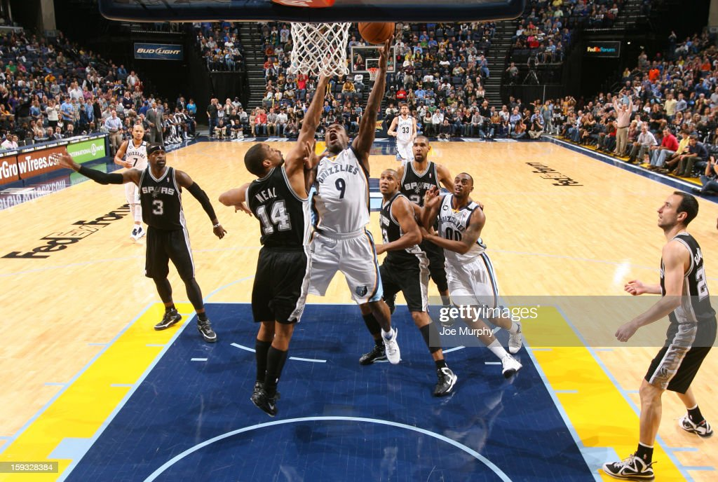 Tony Allen #9 of the Memphis Grizzlies shoots against Gary Neal #14 of the San Antonio Spurs on January 11, 2013 at FedExForum in Memphis, Tennessee.
