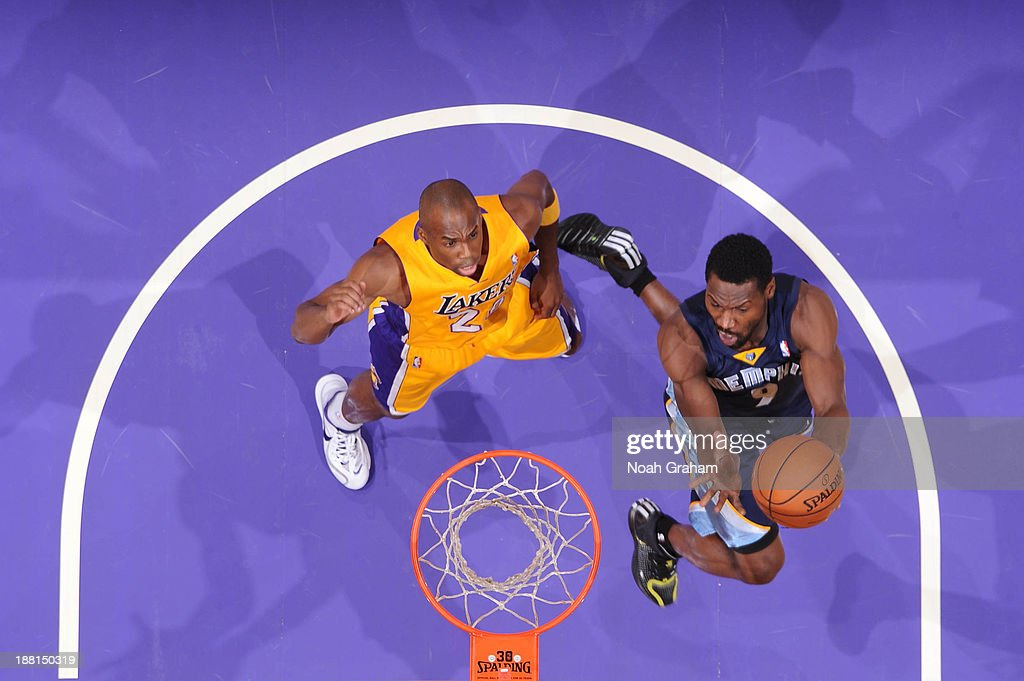 <a gi-track='captionPersonalityLinkClicked' href=/galleries/search?phrase=Tony+Allen+-+Basketball+Player&family=editorial&specificpeople=201665 ng-click='$event.stopPropagation()'>Tony Allen</a> #9 of the Memphis Grizzlies shoots against <a gi-track='captionPersonalityLinkClicked' href=/galleries/search?phrase=Jodie+Meeks&family=editorial&specificpeople=4001727 ng-click='$event.stopPropagation()'>Jodie Meeks</a> #20 of the Los Angeles Lakers at Staples Center on November 15, 2013 in Los Angeles, California.