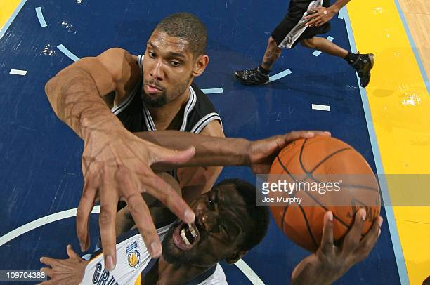 Tony Allen of the Memphis Grizzlies shoots against Tim Duncan of the San Antonio Spurs on March 1 2011 at FedExForum in Memphis Tennessee NOTE TO...