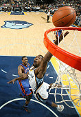 Tony Allen of the Memphis Grizzlies shoots while being fouled by Shawne Williams of the New York Knicks on March 9 2011 at FedExForum in Memphis...