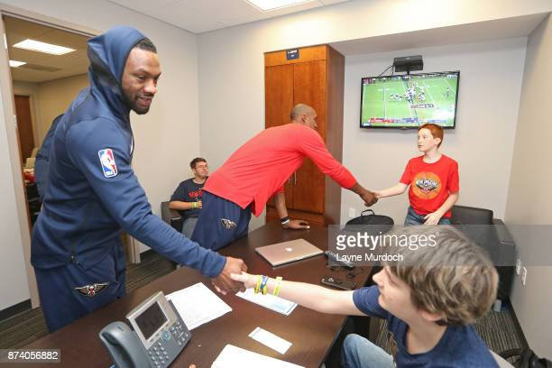 Tony Allen of the New Orleans Pelicans participates in a game day experience with Ochsner Health System Hero of the Game Allen Dedon before the game...
