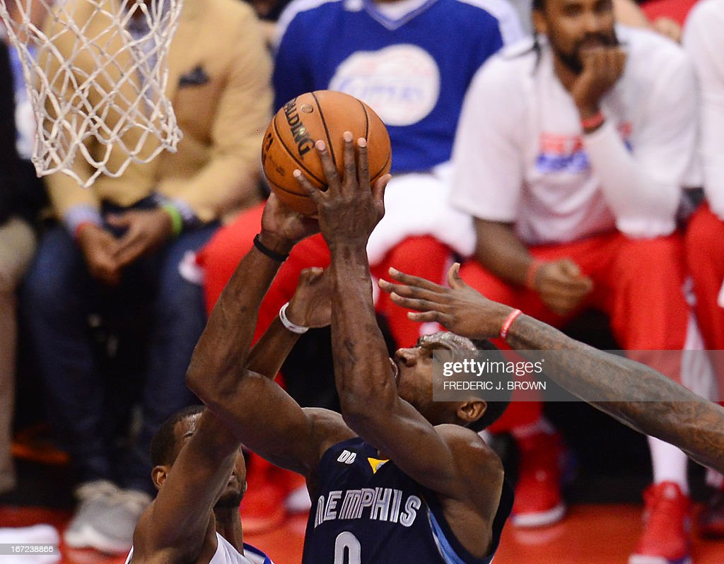 Tony Allen (C) the Memphis Grizzlies goes the the basket against Chris Paul (L) and DeAndre Jordan (R) of the LA Clippers during game two of their NBA Basketball playoff series at Staples Center in Los Angeles, California on April 22, 2013. AFP PHOTO / Frederic J. BROWN