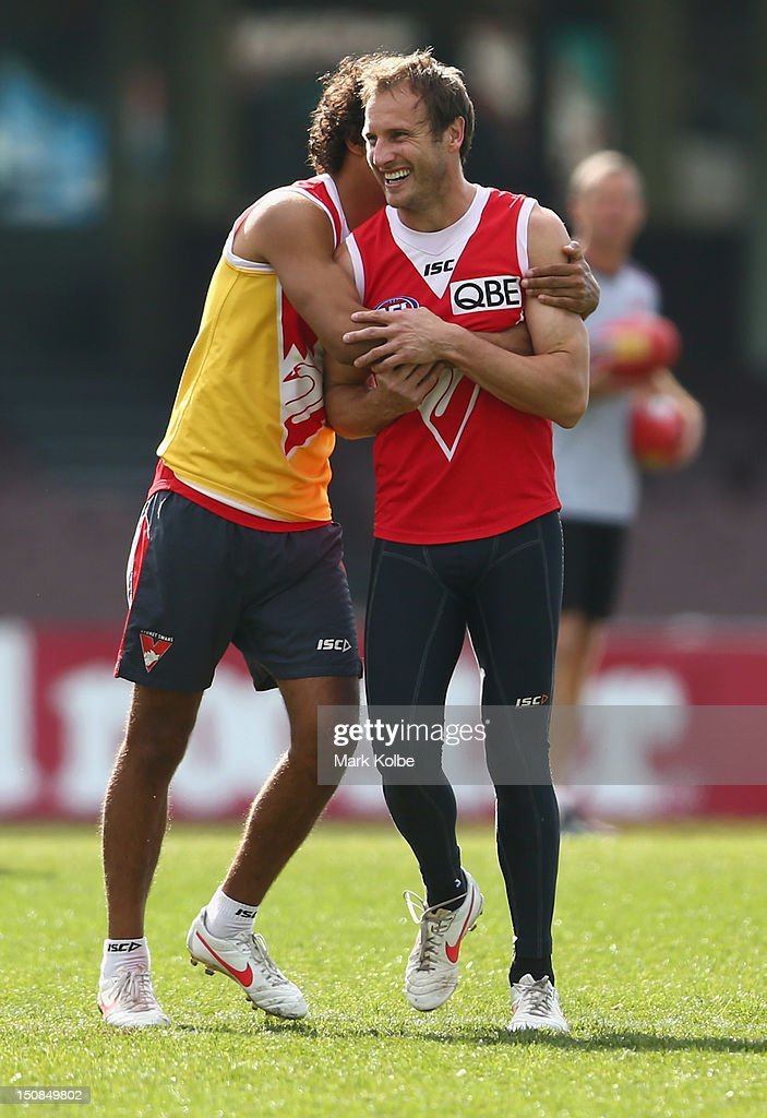Tony Armstrong and Jude Bolton share a laugh during a Sydney Swans AFL training session at Sydney Cricket Ground on August 28, 2012 in Sydney, Australia.