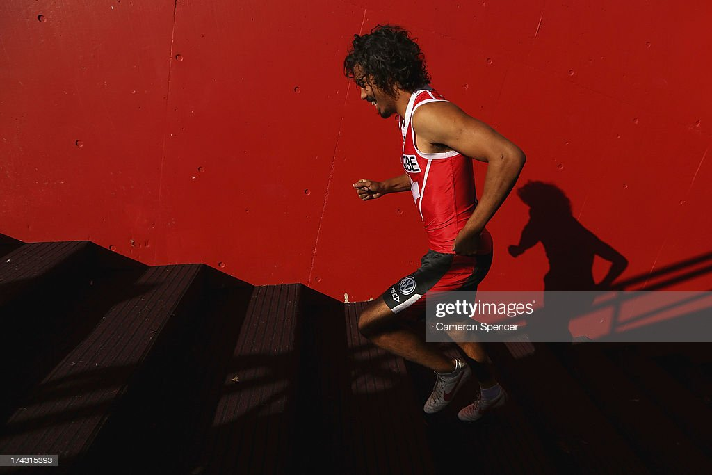 Tony Armstrong of the Swans runs up the players race during a Sydney Swans AFL training session at Sydney Cricket Ground on July 24, 2013 in Sydney, Australia.