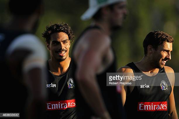 Tony Armstrong warms up with teammates during the Collingwood Magpies AFL IntraClub match at Olympic Park on February 19 2015 in Melbourne Australia