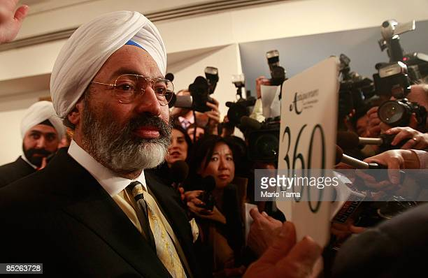 Tony Bedi a representative for winning bidder Vijay Mallya who owns Kingfisher beer speaks to the media after a controversial auction of Indian...