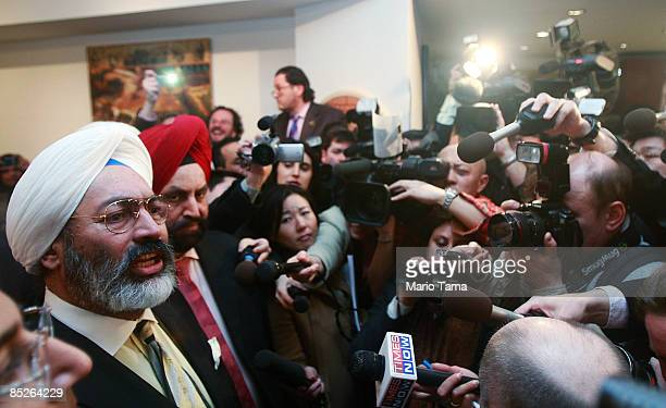 Tony Bedi a representative for winning bidder Vijay Mallya who owns Kingfisher beer speaks to the media after a contoversial auction of Indian...