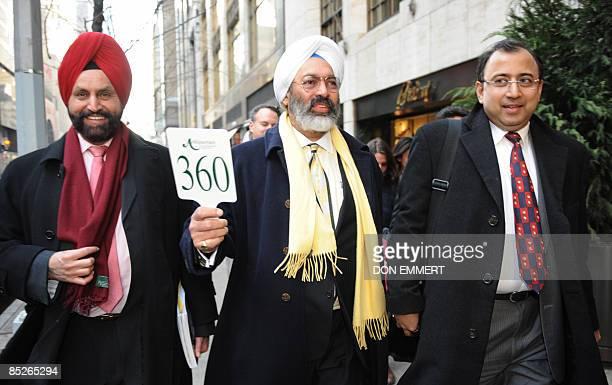 Tony Bedi Atul Kumari representatives for winning bidder Vijay Mallya who owns Kingfisher beer along with Indian businessman Sant Chatwal walk down...