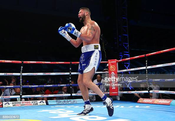 Tony Bellew celebrates after stopping Illunga Makabu in the second round to win the Vacant WBC World Cruiserweight Championship fight between Tony...
