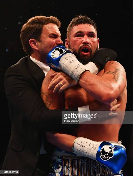 Tony Bellew celebrates an 11th round TKO victory over David Haye with promoter Eddie Hearn after their Heavyweight contest at The O2 Arena on March 4...