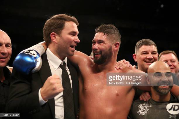 Tony Bellew celebrates victory over David Haye alongside promoter Eddie Hearn and trainer Dave Coldwell after the heavyweight contest at The O2 PRESS...