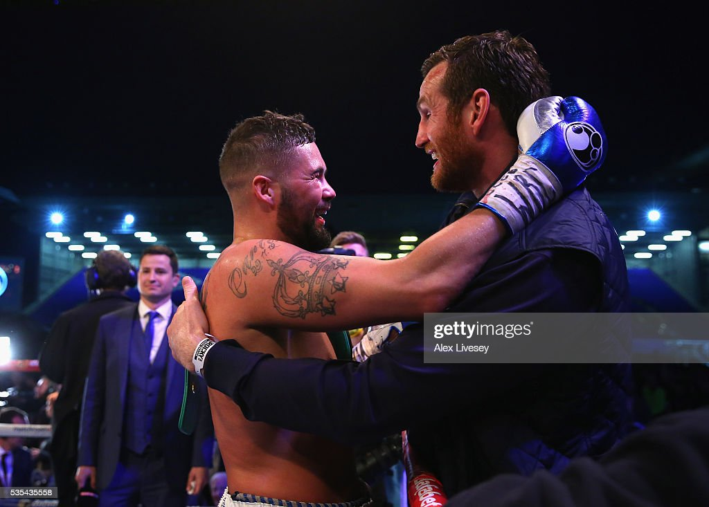 Tony Bellew celebrates with David Price after stopping Illunga Makabu in the second round to win the Vacant WBC World Cruiserweight Championship fight between Tony Bellew and Illunga Makabu at Goodison Park on May 29, 2016 in Liverpool, England.